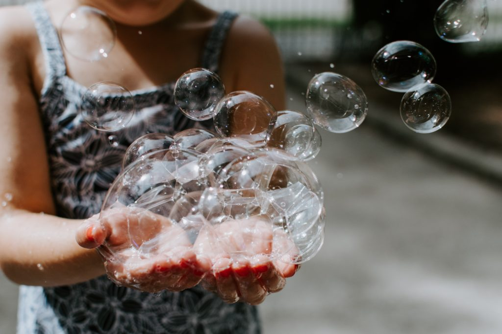 making play matter hands holding bubbles